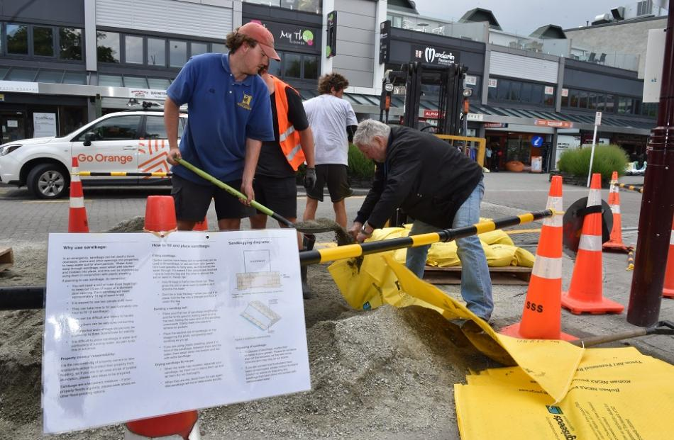 Sandbags being filled in Queenstown on Friday. Photo: Gregor Richardson