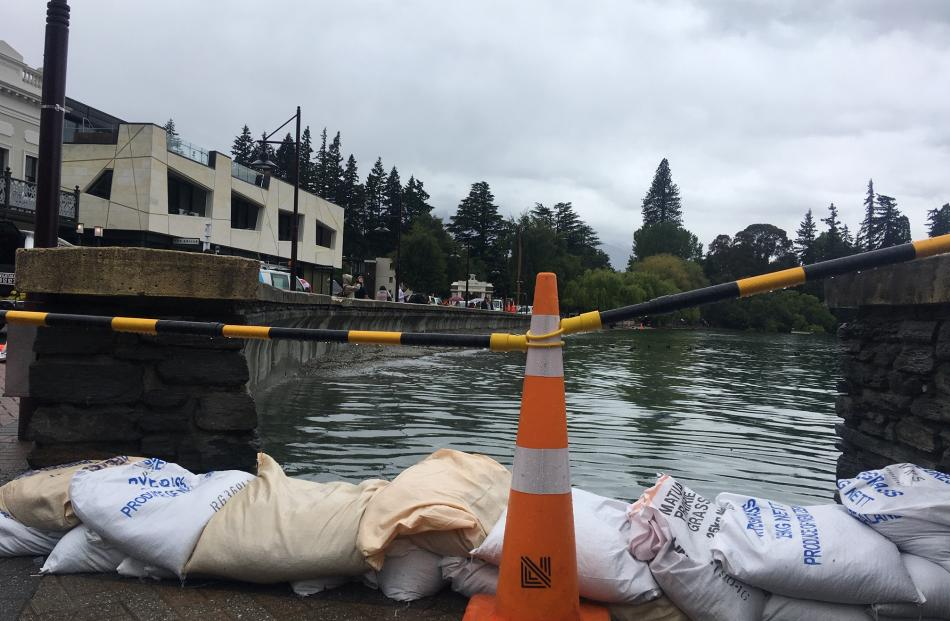 Sandbags placed at the entrance to Queenstown Bay where levels of Lake Wakatipu are high. Photo: Louise Scott