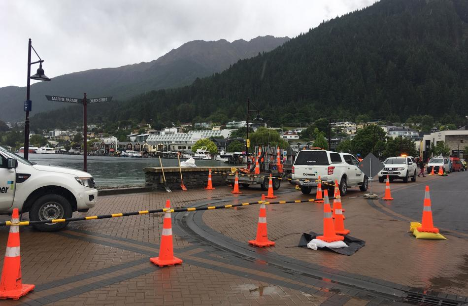 Council contractors have been putting sandbags and cordons in place this morning. Photo: Louise Scott