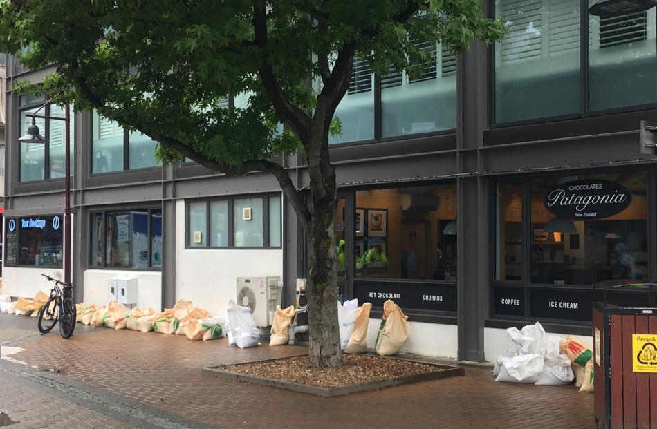 Some Queenstown businesses have put some sandbags in place. Photo: Louise Scott