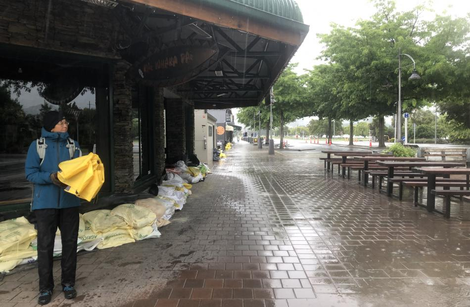 The Wanaka CBD is all but abandoned as lake levels rise and very few tourists have braved the conditions. Photo: Kerrie Waterworth
