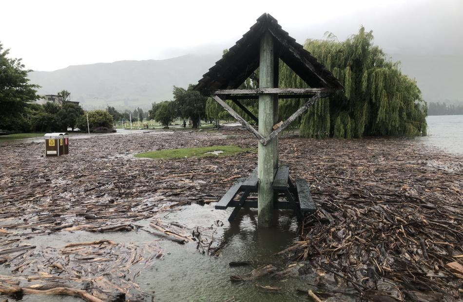 Water floods areas near the lakefront in Wanaka this morning. Photo: Kerrie Waterwroth