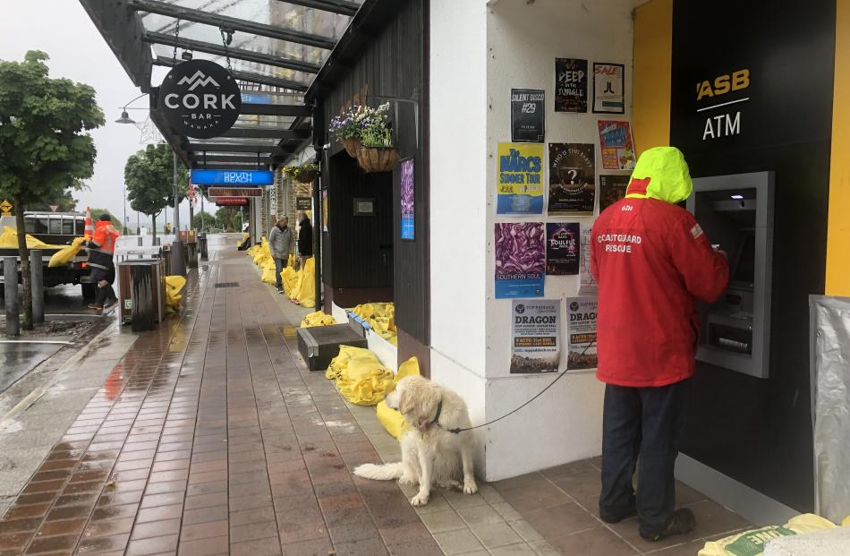Stores are framed by sandbags in the Wanaka CBD. Photo: Kerrie Waterworth