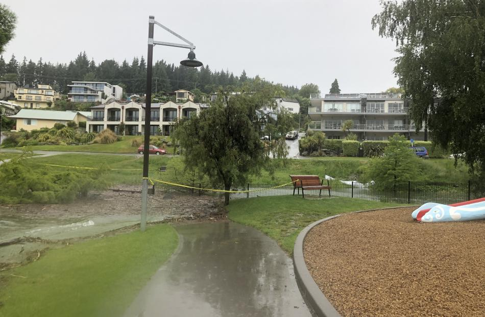 Overnight water had started to enter the Dinosaur Park playground and this morning contractors were out sandbagging the public toilets near the log cabin. Photo: Kerrie Waterworth
