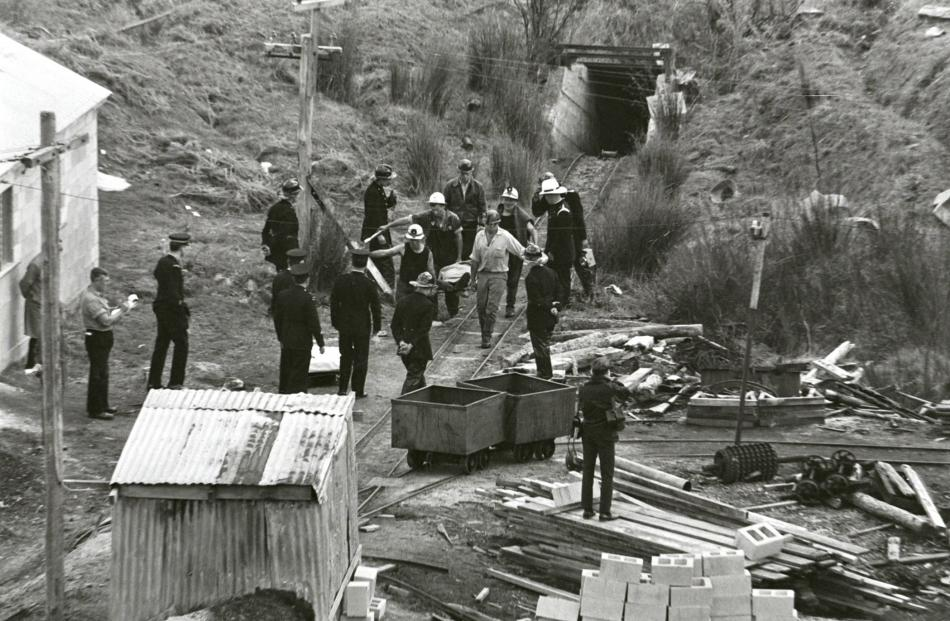A sad moment as miners bring the body of Mervyn Thomas out of the mine where a fall of rock and...