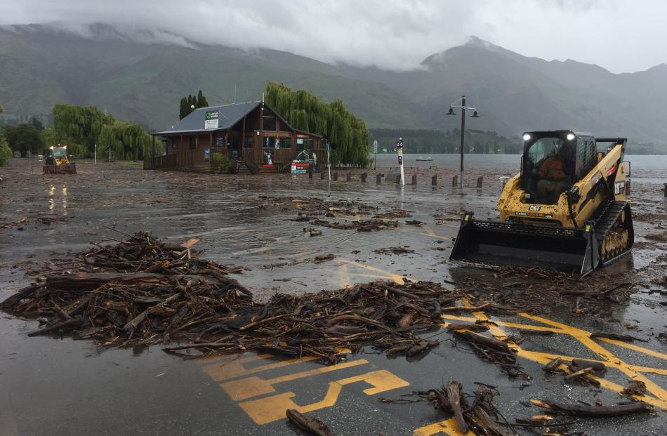 Debris is cleared from near the Log Cabin on Wanaka's waterfront.