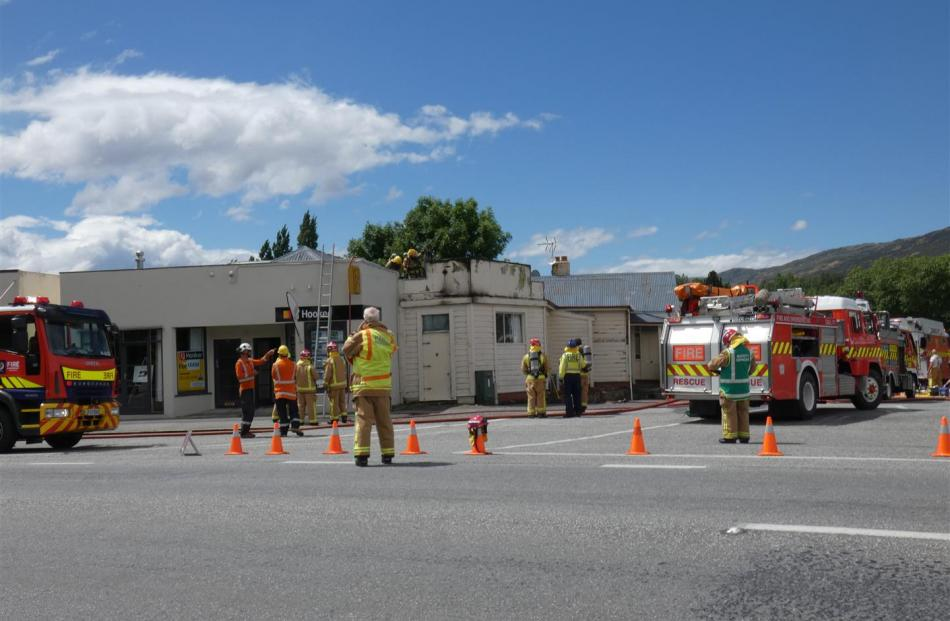 Emergency services at the scene of the fire at the local branch of LJ Hooker in Roxburgh. Photo: Simon Henderson