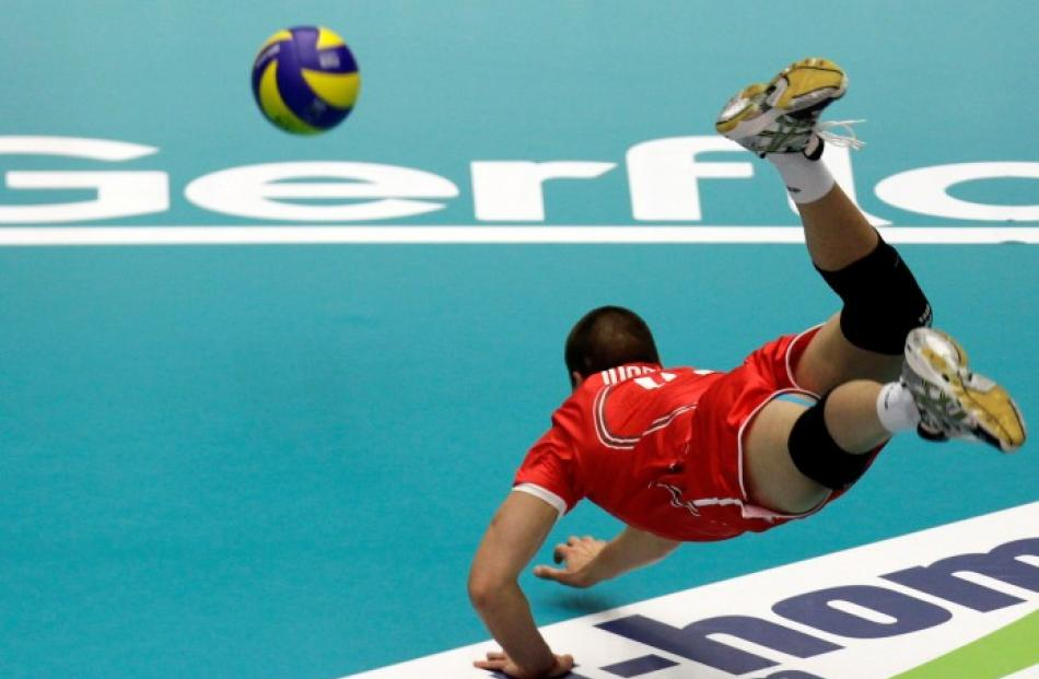 Bulgaria's Vladislav Ivanov dives for the ball during his side's European Volleyball Championship...