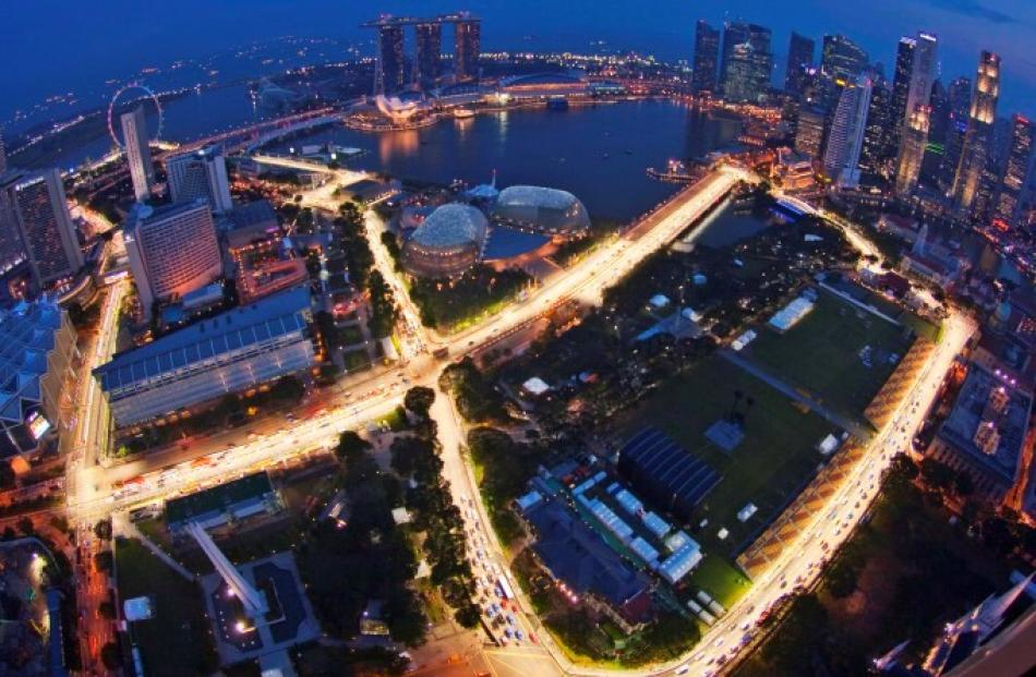 An aerial view shows part of the illuminated Marina Bay street circuit of the Singapore Grand...