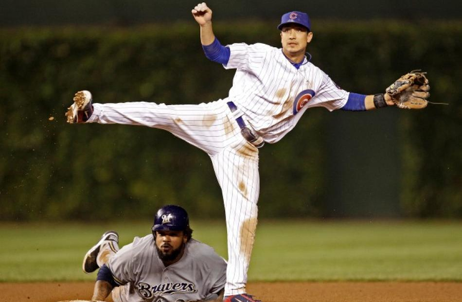 Milwaukee Brewers' Prince Fielder breaks up a double play attempt by Chicago Cubs' Darwin Barney...
