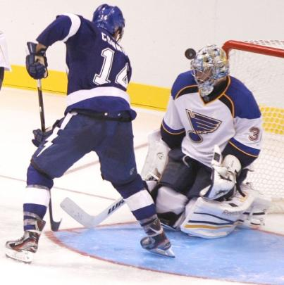 The Tampa Bay Lightning's Brett Connolly deflects a shot over the head of St. Louis Blues goalie...