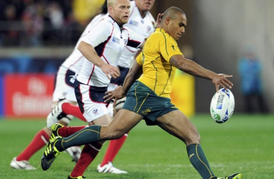 Australia Wallabies captain Will Genia kicks the ball during their Rugby World Cup Pool C match...