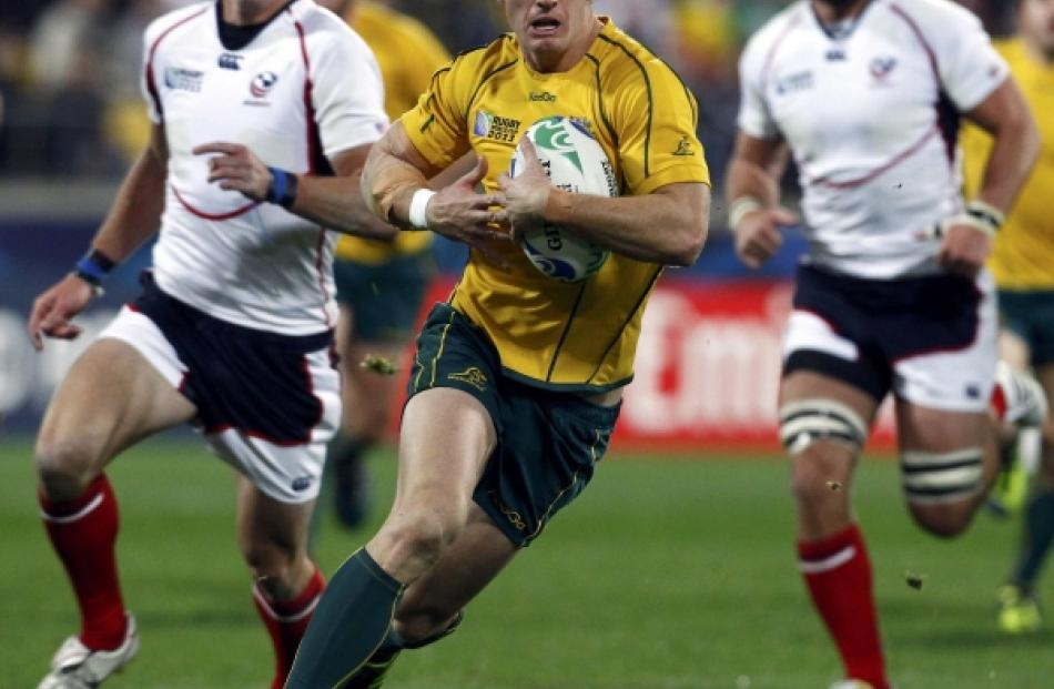 Australia Wallabies' Rob Horne runs with the ball during their Rugby World Cup Pool C match...