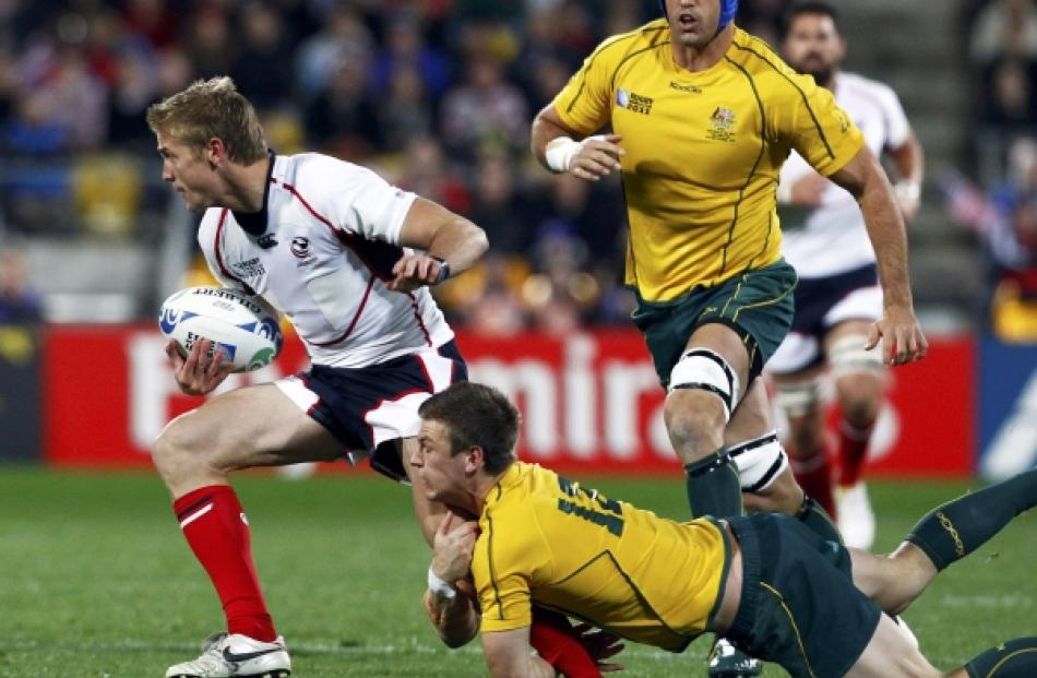 Australia Wallabies' Rob Horne tackles Colin Hawley (left) of the US during their Rugby World Cup...