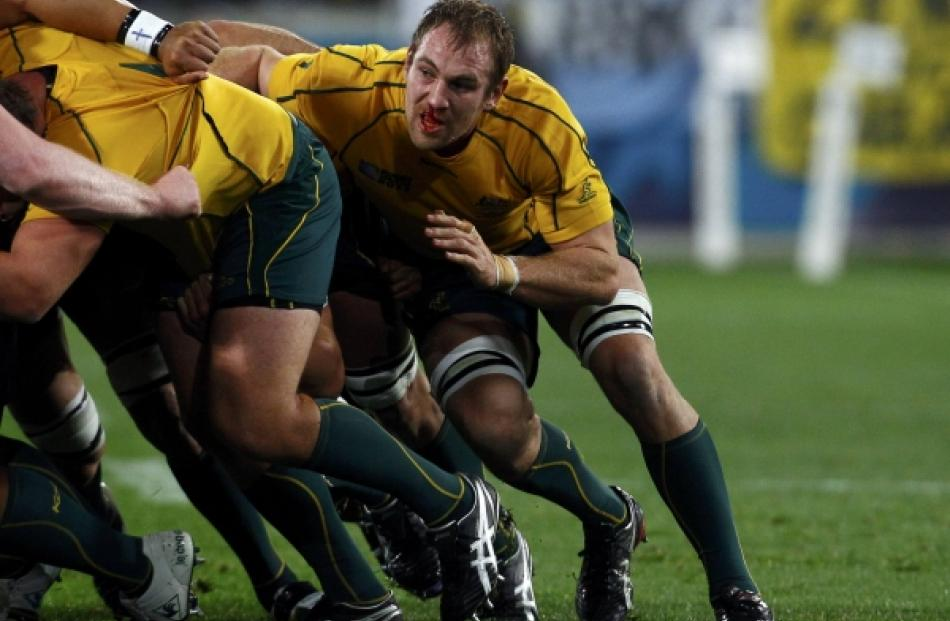Australia Wallabies' Rocky Elsom (right) contests a scrum during their Rugby World Cup Pool C...