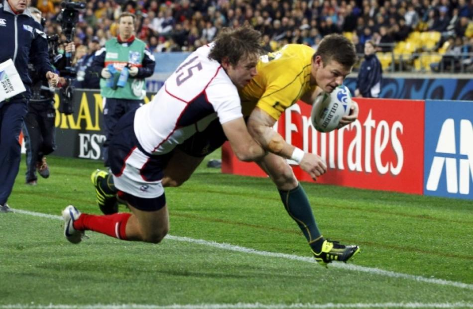 Blaine Scully of the US fails to prevent Australia Wallabies' Rob Horne (right) from scoring...
