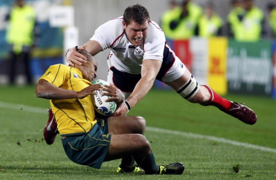 Hayden Smith (right) of the US tackles Australia Wallabies captain Will Genia during their Rugby...