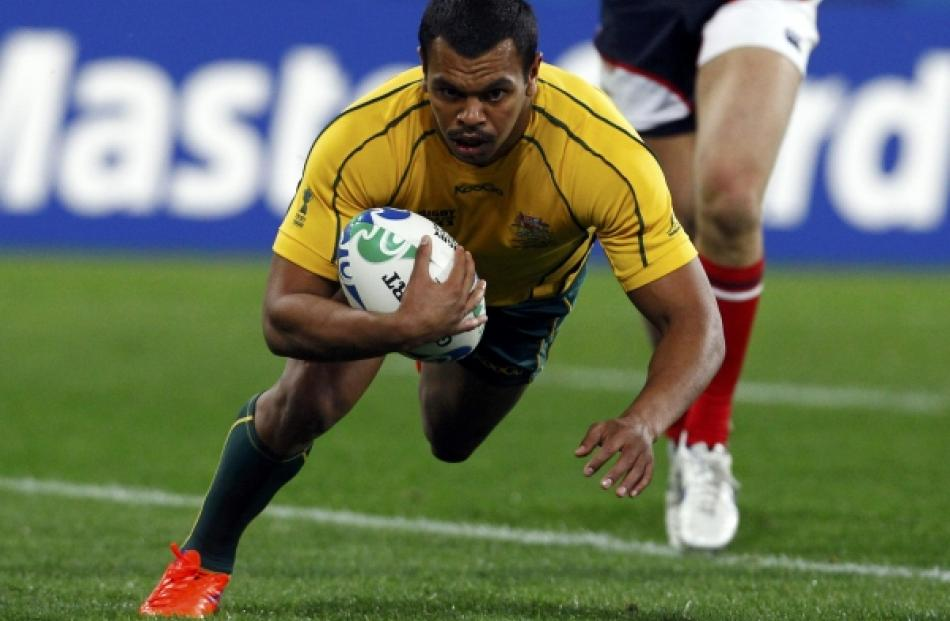 ustralia Wallabies' Kurtley Beale scores a try during their Rugby World Cup Pool C match against...