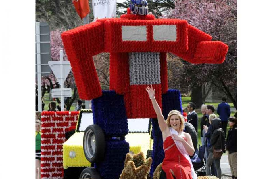 Princess Shaun Robinson waves to friends from the Alexandra New World's 'Transformers' float.