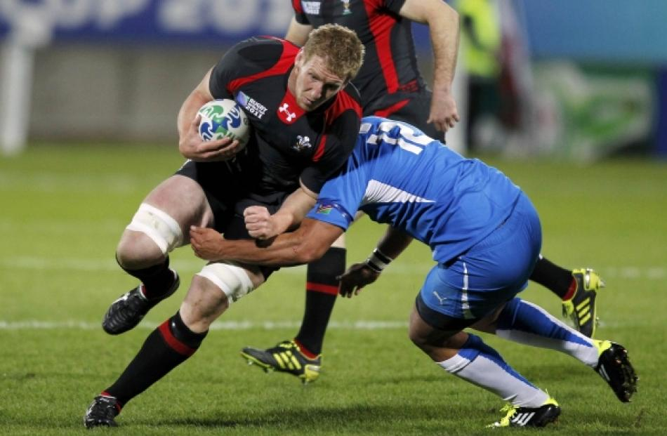 Namibia's Darryl De La Harpe (right) tackles Wales' Bradley Davies during their Rugby World Cup...