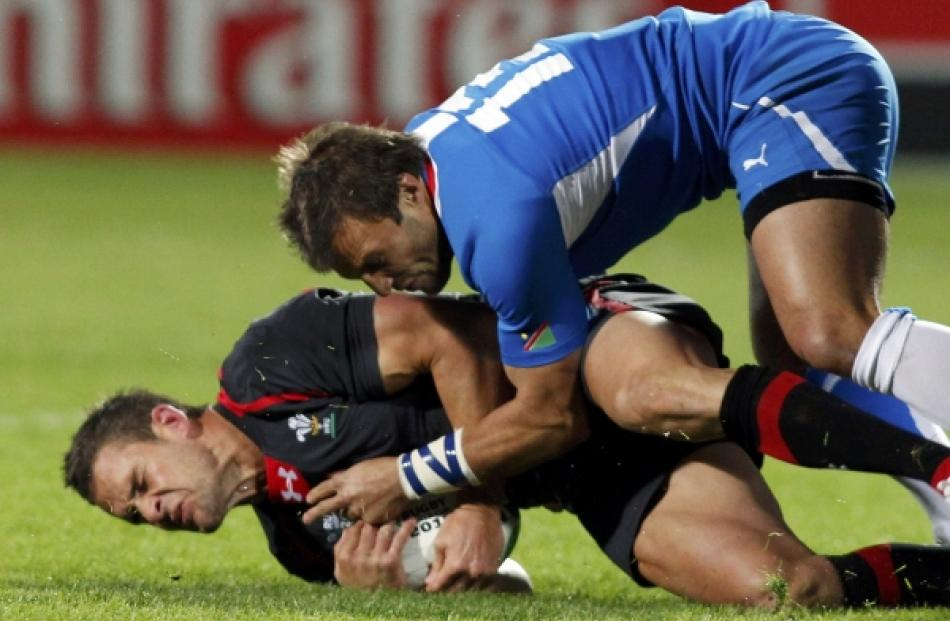 Namibia's Piet Van Zyl (right) tackles Wales' Lee Byrne during their Rugby World Cup Pool D match...