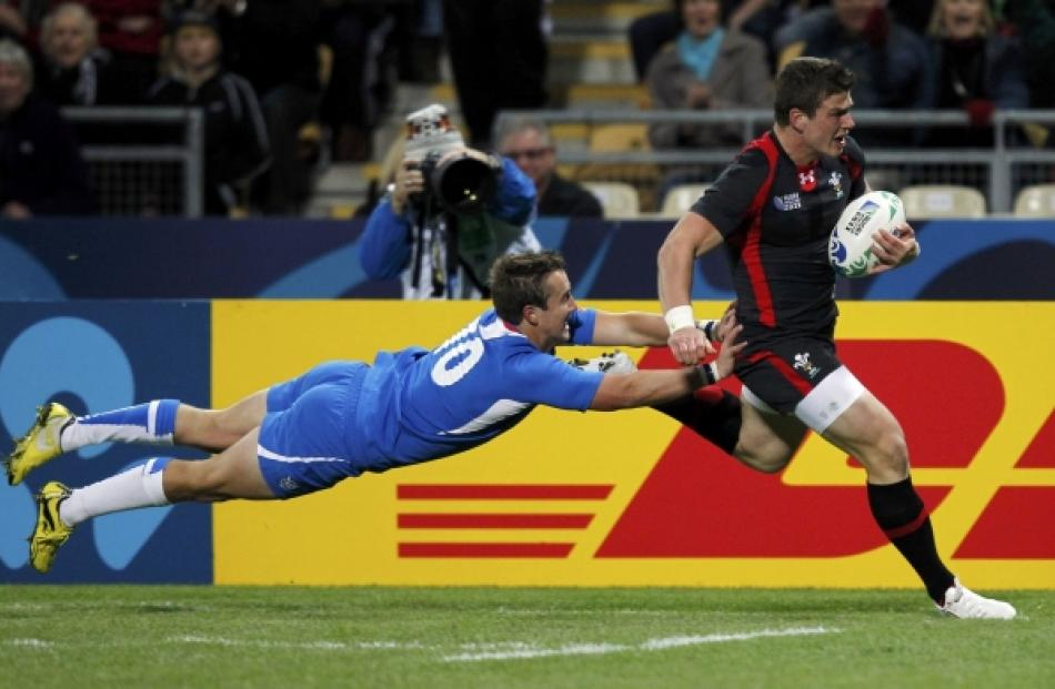 Namibia's Theuns Kotze (left) fails to prevent Wales' Scott Williams from scoring during their...