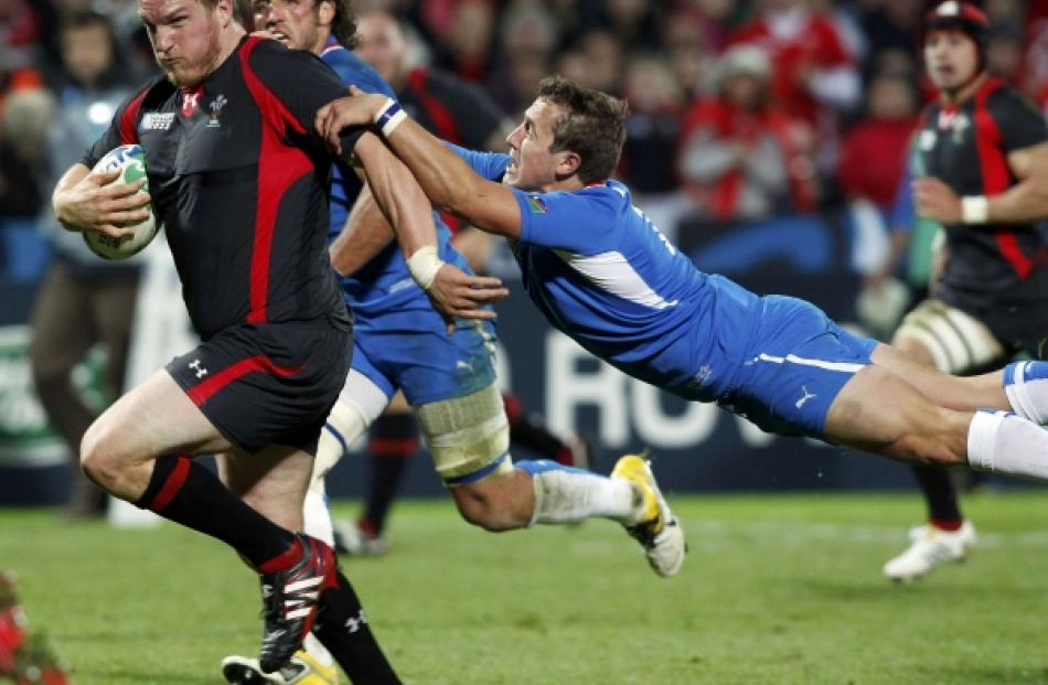 Namibia's Theuns Kotze (right) attempts to tackle Wales' Gethin Jenkins during their Rugby World...