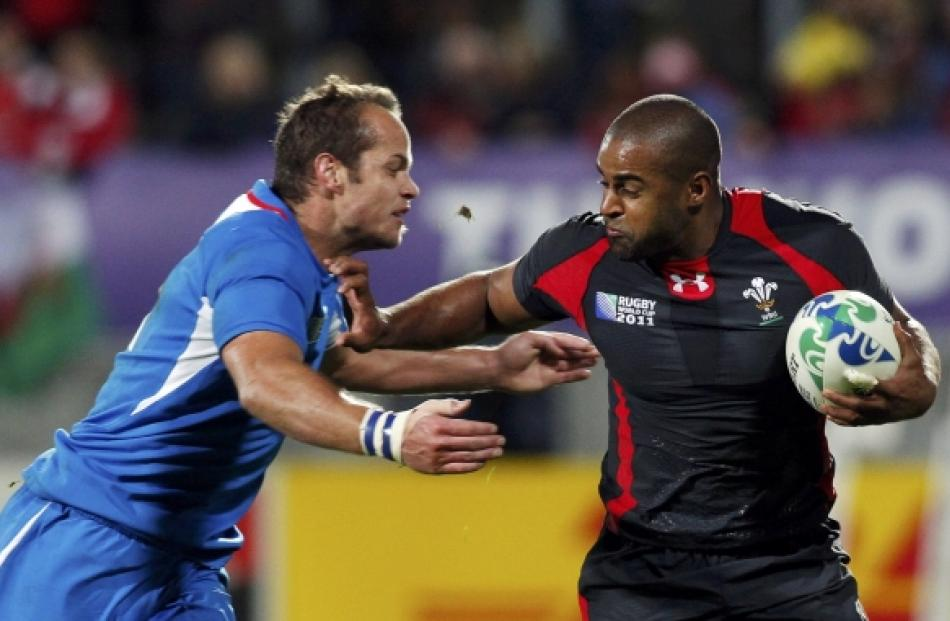Wales' Aled Brew (right) fends off Namibia's Danie Dames during their Rugby World Cup Pool D...