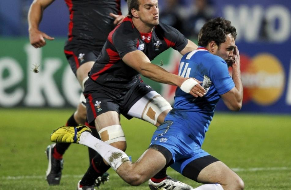 Wales captain Sam Warburton (left) tackles Namibia's Danie Van Wyk during their Rugby World Cup...