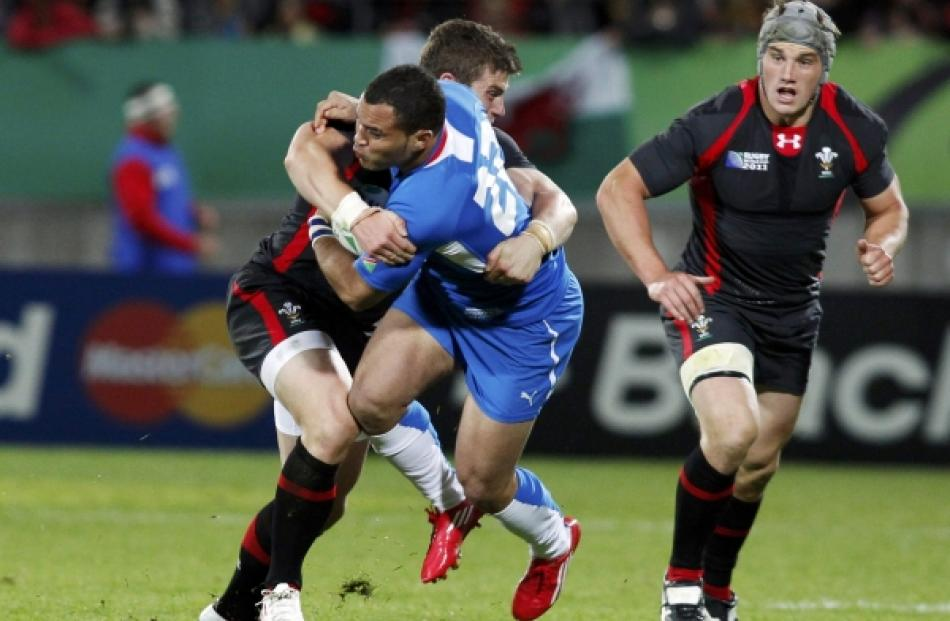 Wales' Scott Williams (left) tackles Namibia's David Philander during their Rugby World Cup Pool...