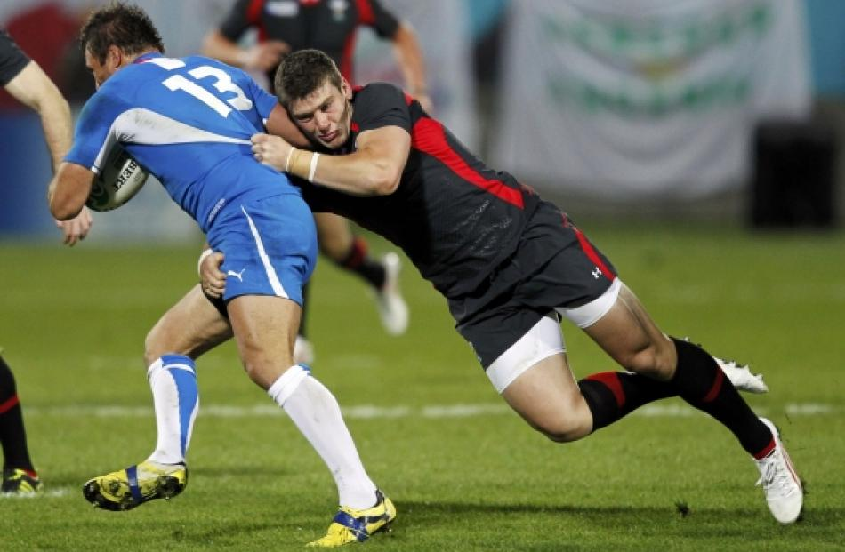 Wales' Scott Williams (right) tackles Namibia's Piet Van Zyl during their Rugby World Cup Pool D...