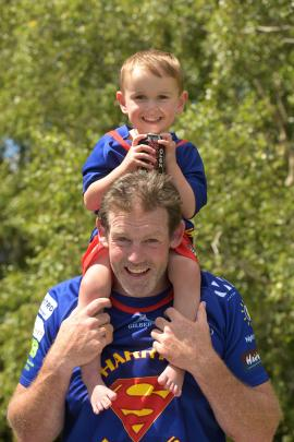 Harry Finch (3) rides high on the shoulders of ex-All Black Tom Donnelly at a Spartans 10s...