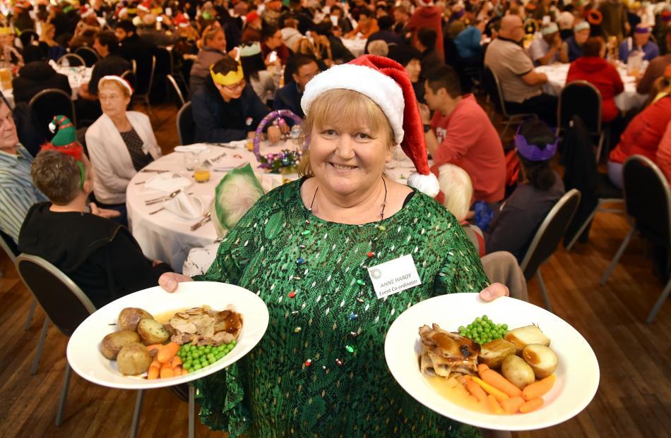 Dunedin Community Christmas Dinner co-ordinator Anne Hardy prepares to serve Christmas dinner.