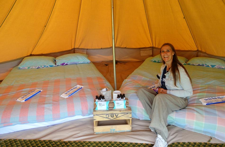 Glamping manager Louise Garland in one of the glamping tents for four people, featuring two...