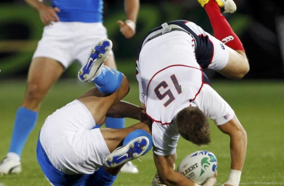 Italy's Gonzalo Canale (left) tackles Chris Wyles of the US during their Rugby World Cup Pool C...