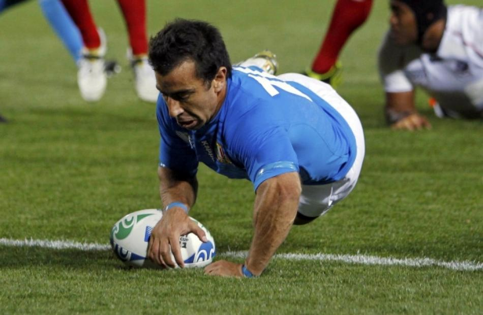 Italy's Luciano Orquera scores a try during their Rugby World Cup Pool C match against the US at...