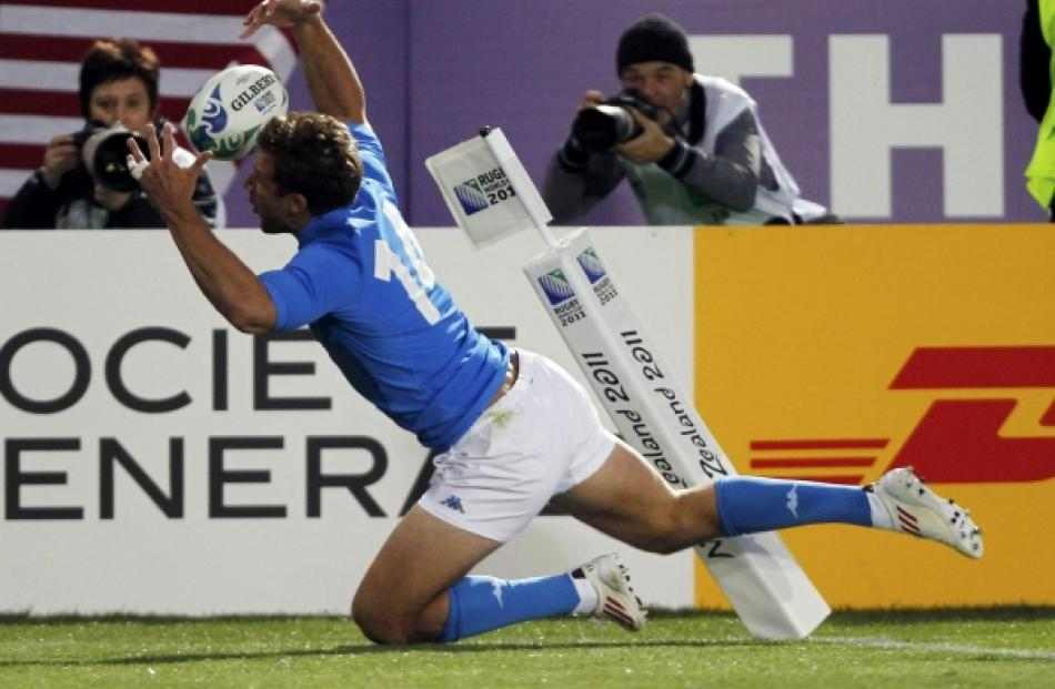 Italy's Tommaso Benvenuti fumbles the ball as he attempts to score during their Rugby World Cup...