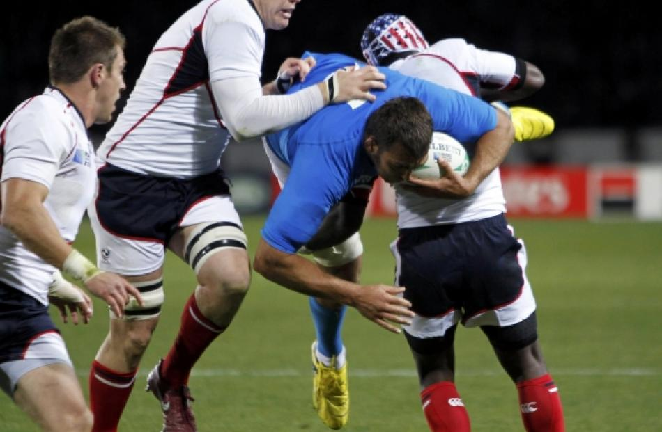 Takudzwa Ngwenya (right) of the US tackles Italy's Quintin Geldenhuys during their Rugby World...