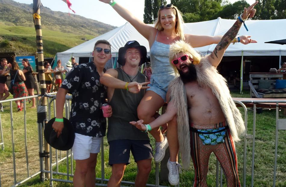 The hot temperatures at Rhythm and Alps on New Year's Eve inspired a range of clothing, such as...
