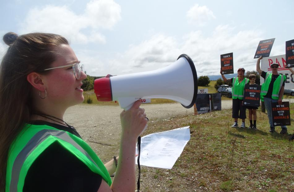 Kat Gollop of the Queenstown Vegan Society and 10 supporters protest at the entrance to the...