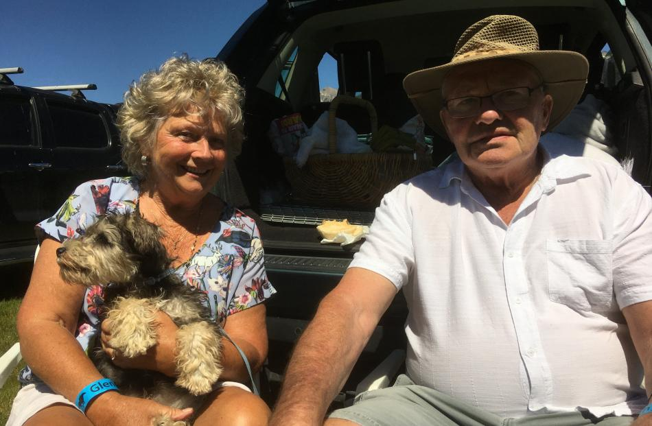Bronwyn and Gordon Murphy, of Arrow Junction, and miniature schnauzer Bobby (3 months).