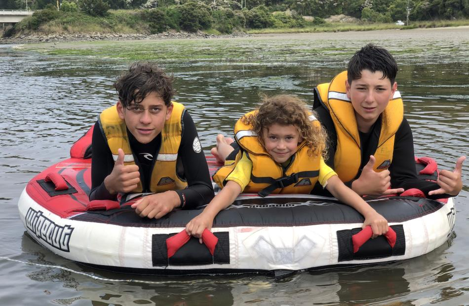 Having fun at Taieri Mouth on the biscuit are (from left) Kaynen Dorr (13), Leila Porteous (6) and Flynn Weatherall (13). Photo: Mark Weatherall