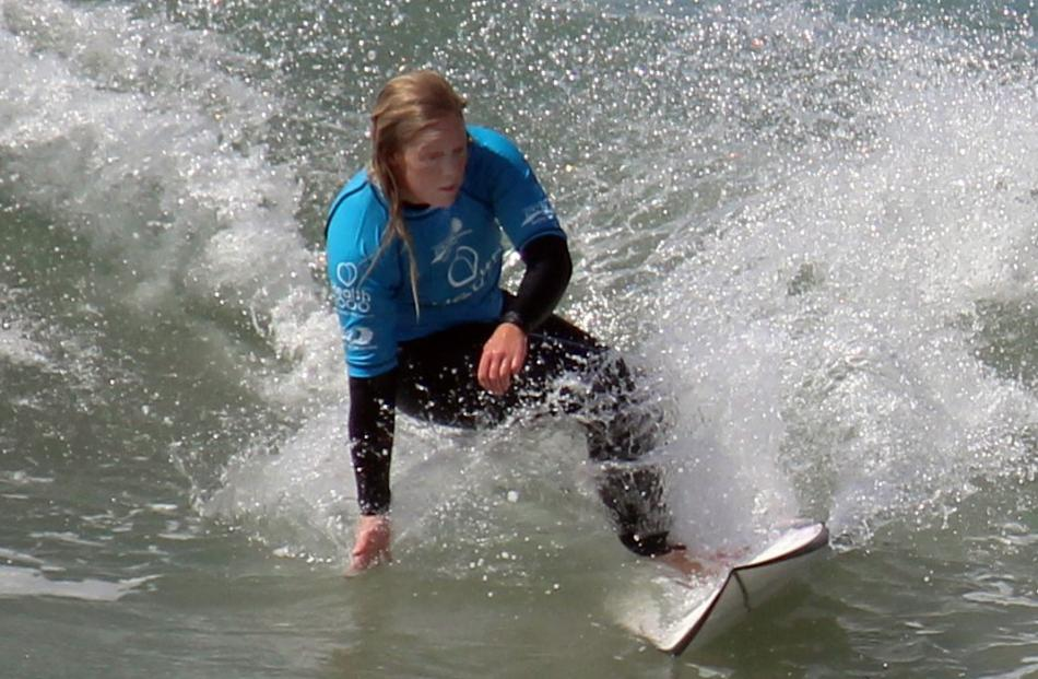 Hayley Pascoe, of Dunedin, competes in the NZ Surf Championship, at St Clair Beach, on Tuesday. Photo: Phil Coakes