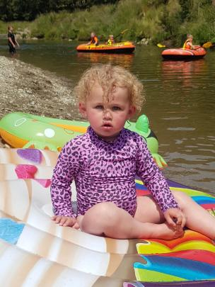 Luca Baldwin (20 months) tries out the inflatables in the Waikaia River at Piano Flat. Photo: Jess McConnell