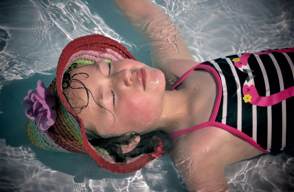 Freya Maxwell (5), of Mosgiel, in the pool in Arrowtown on New Year's Eve. Photo: Loria Maxwell