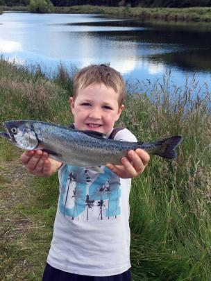 Malachi Turner (6), of Dunedin, holds a catch for dinner at a fishing spot in Te Anau. Photo:...