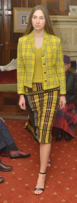 Grace Roseler, from Aart Model Management, wears  an asymmetric yellow plaid skirt, knit jumper...