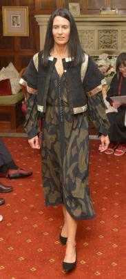 Bridget  wears British designer Jean Muir's black suede jacket with silver snakeskin trim over a...