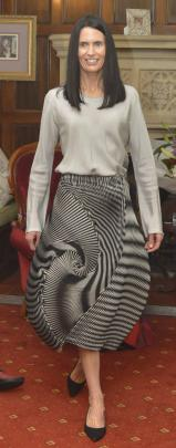 Bridget  models exquisite Japanese design, wearing a grey Comme des Garcon shirt and a striped...