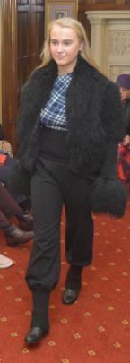 Charlotte Wheeler, from Aart Model Management, wears luxury fashion brand Joseph, exhibiting a Mongolian sheepskin jacket in black.